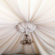 14 Ways to Cover a Hideous Ceiling fabric ceiling gather -- This is actually a ceiling! Drop Ceiling Panels, Drop Ceiling Tiles, Drop Down Ceiling, Fabric Ceiling, Ceiling Draping, Dropped Ceiling, Ceiling Canopy, Ceiling Decor, Ceiling Design