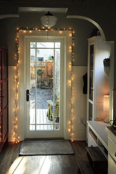 Bring light to midwinter days. A strand of white twinkle lights, extra candles and soft lamplight have a cheering effect in winter. So if it's a gray day, why not light a few candles and plug in the twinkle lights while you relax at home? It's so much lovelier that way.~eclectic kitchen by Julie Smith
