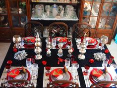 Plum Creek Place - New Years Eve Tablescape. mirrored chargers. silver red black