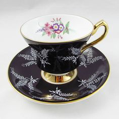 Beautiful bone china tea cup made in England by Windsor. Tea cup and saucer are black with white leaf design and floral bouquet. Gold trimming on cup and saucer edges. Excellent condition (see photos). The markings read: Bone China Windsor Made in England Antique Tea Cups, Vintage Tableware, Bone China Tea Cups, White Leaf, Chinese Tea, Best Tea, Vintage Tea, High Tea, Cup And Saucer
