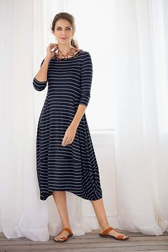 Bold pinstripes animate an indispensable dress defined by flattering seaming details and a distinctive scooped hem. Striped Kati Dress by Comfy USA: Knit Dress available at www.artfulhome.com