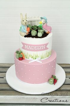 Girly Peter Rabbit cake--although I hate fondant, I like the soft pink with tiny polka dots and ribbon