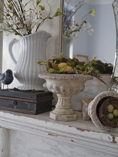 Chateau Chic: Spring Mantel...Love the box, or stacked books with a vase on top