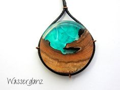This pendant has been handmade from a piece of wood and a mixture of blue and green resin. Handmade statement jewellery, designed by me, and made by me in Düsseldorf, Germany I take inspiration from the beautiful designs found in nature and the things around me, to create captivating