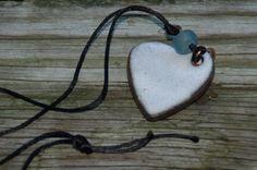 white ceramic heart pendant on a black silk by brookhousepottery, $15.00