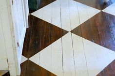 Checkered floor using one color paint and the original wood stain.