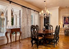 Breakfast room with built-in house systems control station.  #chandeliers