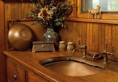 The patina of this copper pantry sink in a 1915 bungalow evolved over time.