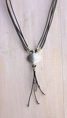 Leather necklace handmade from Spain This necklace is made of genuine leather and silver plated beads. All silver pieces are subjected to an anti-allergic process ( nickel and lead free) with a silver plating of 8 microns of sterling silver. MADE TO ORDER ! I make this to be 18 45cm
