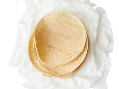 How to soften your corn tortillas. Steam corn tortillas in the microwave so they stay pliable and don't split under the weight of taco fillings. Wrap a stack of tortillas in damp paper towels or a damp kitchen towel, then wrap in plastic wrap or place in a microwave-safe resealable plastic bag (keep the bag open to vent). Microwave until warm and flexible, about 1 minute.
