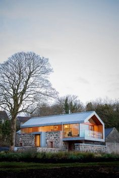modern vernacular architecture, would fit into the Tennessee landscape. Modern barn by McGarry-Moon Architects in N. Ireland, blends the original stone barn with modern features of metal roof, glass railings-a beautiful blend of old & new. Residential Architecture, Amazing Architecture, Interior Architecture, Contemporary Architecture, Contemporary Design, Building Architecture, Classical Architecture, Modern Roof Design, Installation Architecture