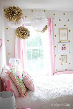 A cute girl's room decorated with gold and pink