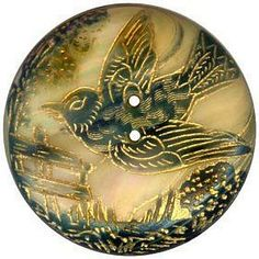 Carved & dyed mother-of-pearl button.