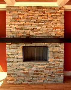 Stacked stone fireplace w/cherry mantle