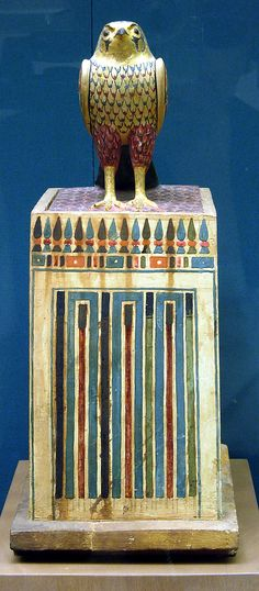 Canopic chest, falcon    Period:      Ptolemaic Period  Date:      305–30 B.C.  Geography:      Egypt  Medium:      Wood, paint, gold leaf  Dimensions:      Base 0.33m x H. 0.582m