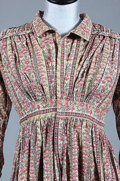 * block printed cotton day dress, 1820s, front opening bodice with high waistline into which fan-pleated gathers are caught front and back, long, narrow sleeves with ruffled cuffs, side slits for access to pockets