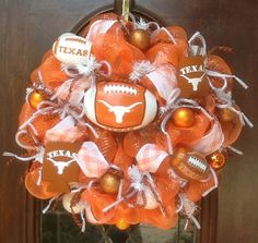 This 24 inch Astros deco mesh wreath has footballs, decorative balls and flex tubing all to show how proud you are of the Astros when you hang this