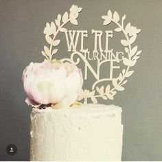 Lovely little regram from @wallace_cake_house featuring our 'we're turning one' wooden bespoke cake topper x gorgeous bloom on a fab cake  pretty! #lasercut #wooden #caketopper #celebration #turningone #bespoke #etchedstudio