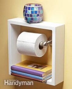 Take a deep shadow box picture frame and hung it around your toilet paper holder. It gives you two convenient shelves for small items in small bathroom. http://hative.com/clever-toilet-paper-storage-or-holder-ideas/