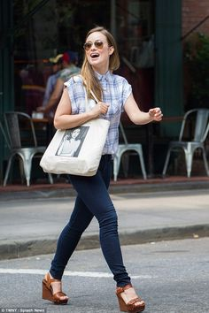 Happy-go-lucky: The 31-year-old actress looked happy and carefree as she headed to Cafe Cl...