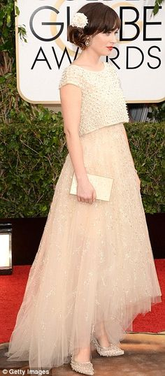 Dream in cream: Zooey Deschanel looked pretty as a picture in an Oscar De La Renta gown and matching heels