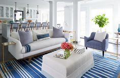 """The custom-sized throw, wrapped around both sides of the seat cushion, protects the couch with a """"washable barrier,"""" as Cassie puts it, for any spills. The cushions add more layers of washable fabric and ramp up the easy, colorful style."""