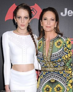Lovely ladies: Eleanor showed off her trim figure in a two-piece white number