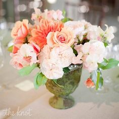 I love peonies and I love this color combo for the wedding.  Peach, coral, light pink, probably with grey suits and bridesmaids dresses!
