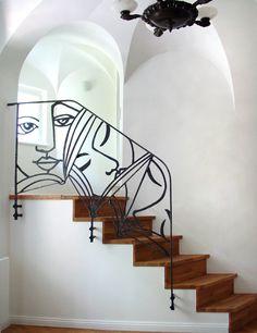 """Treppengitter """"Lesestunde"""", Stahl geschmiedet, Höhe ca. 2,5 m. Umsetzung des Entwurfes der Malerin Uliane Borchert für eine Bibliothek."""