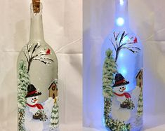 Snowman Bottle Light, Winter Bottle Light, Christmas Bottle Light, Holiday Bottle Light, Hand Painted Bottle Light by BringtheJoyCreations on Etsy Painted Wine Bottles, Lighted Wine Bottles, Painted Jars, Bottle Lights, Hand Painted, Glass Bottle Crafts, Diy Bottle, Bottle Art, Christmas Wine Bottles