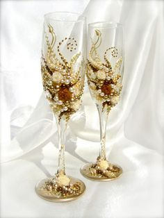 Wonderful Wedding champagne glasses, elegant toasting flutes in ivory, gold and brown, set of 2. $56.00, via Etsy.