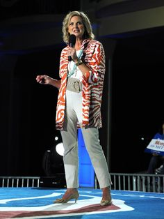 Ann Romney- A zebra print coat and statement belt add panache to khakis and a white tee.