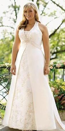 Vestido de novia de satén, con cuello halter y con lateral encañonado con encaje, con corsé bordado con mostacillas y parte invertida de organza.