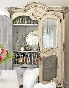 Armoire serving as your bar - in my home, I am using a large upright china hutch with stained glass windows in the top, but I think I like this idea even more!
