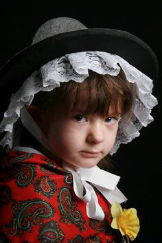 Welsh girl wearing traditional Welsh clothing with the daffodil the national flower of Wales traditionally worn on March 1st St. David's Day.