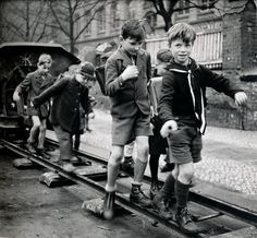 Berlin school children are enjoying themselves on the way to school during 1946, apparently playing 'follow the leader'.