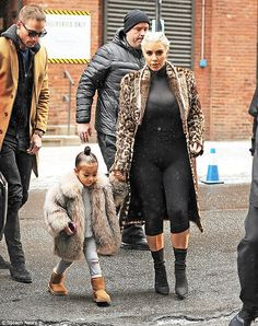 Best foot forward: Kim dutifully wore her Yeezy boots, designed by Kanye