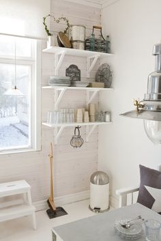 Cheap IKEA brackets look cute. If not in kitchen, maybe pantry?