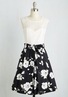 Nuanced Narrator Dress in Black Bouquet. You perch on the tufted sofa in this black-skirted, lace-topped twofer dress, excitedly listening to the radio play unfold. #multi #modcloth