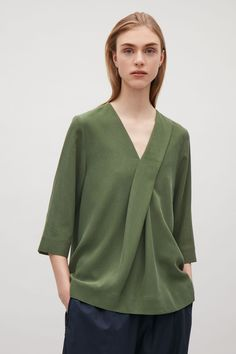 COS image 2 of V-neck top with front pleats in Bottle Green