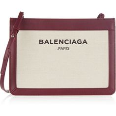 Balenciaga Leather-trimmed canvas shoulder bag ($745) ❤ liked on Polyvore featuring bags, handbags, shoulder bags, burgundy handbag, accessories handbags, purse, canvas handbags and shoulder strap handbags