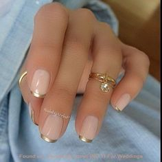 Pink and Gold French Manicure Design.