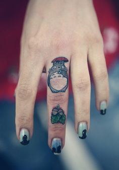 totoro tattoo on the finger. hey im down to get one hahaha