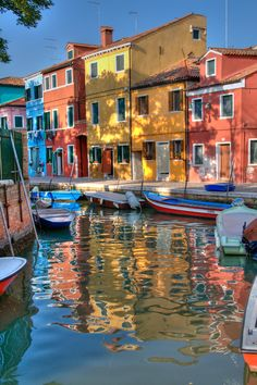 HDR from 1 shot.  I took this photo this summer on the little island of Burano, near Venice, Italy. There, every house is paint with a flashy color. Only a HDR post processing allows to render the true look of the houses and their reflections on the canals.  Looks better On Black