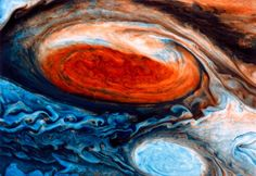 This photograph taken by Voyager 1 shows a close up of the Great Red Spot on Jupiter, a storm that has been raging in the gas giant's atmosphere for at least three hundred years. The white spot shows another cloud system that is believed to have formed around 1940.