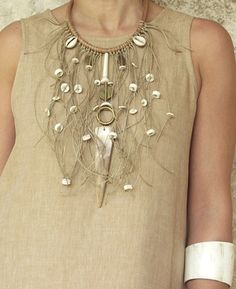 BIB Necklace: leather, white horn, linen string, fish vertebra, african beads