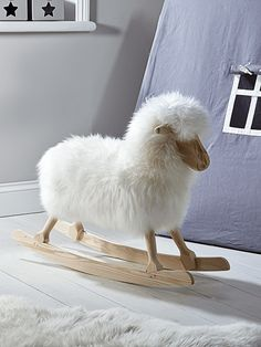 Rocking Sheep - such a sweet idea instead of a rocking horse. Very county chic for a children's bedroom!