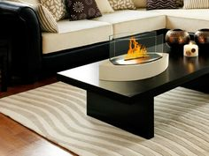 The Lexington model Anywhere Fireplace brings you all the tabletop elegance you are looking for with its distinctive shape, high gloss red finish and its real flames. Easy to move to anywhere you want to enjoy the ambiance of a real fire but without the hassle of smoke, melting wax, soot, ash, smell etc.