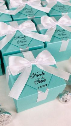 Elegant wedding favor box with satin ribbon bow and custom names, Mint blue bonbonniere. Personalized gift boxes make a unique way to thank guests for attending your special day. #welcomebox #giftbox #personalizedgifts #weddingfavor #weddingbox #weddingfavorideas #bonbonniere #weddingparty #sweetlove #favorboxes #candybox #elegantwedding #partyfavor #tiffanyblue #giftboxes #mintwedding #uniqueweddingfavors #uniqueweddingideas #tiffanytheme #tiffanystyle #tiffanybluewedding
