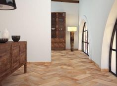 Ceramic wood tile flooring offers a durable, contemporary option for all wood effect flooring. This Cotto Natural tile has a textured finish in matt that makes it great for hallways and other living spaces.